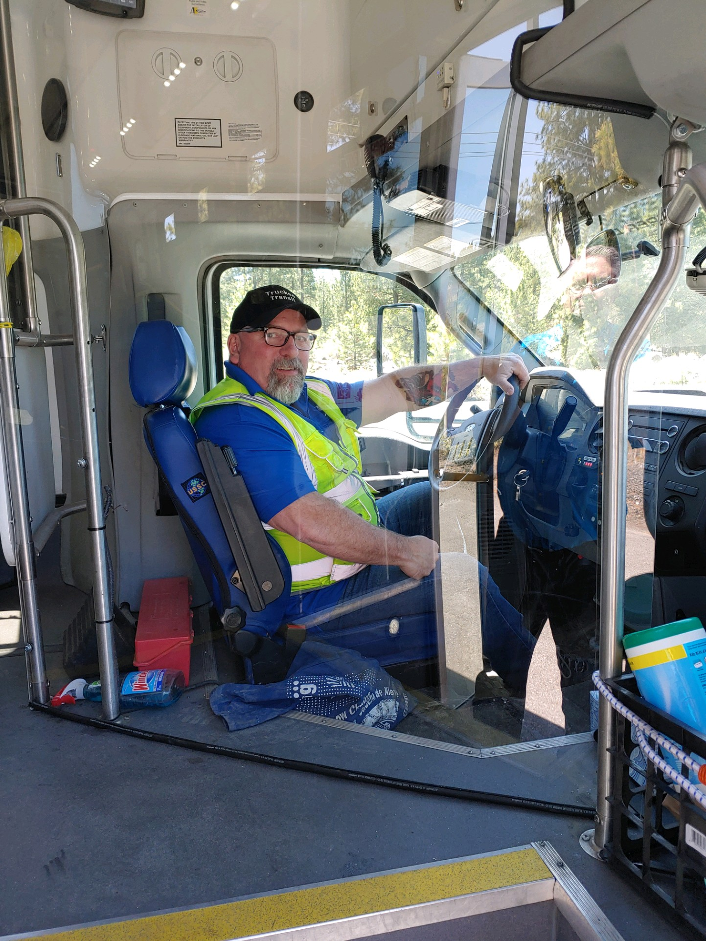 Driver behind plexiglass