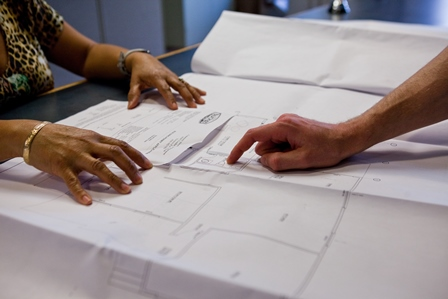 hands inspecting building plans